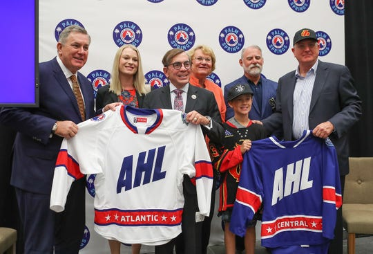 Palm Springs city council members take photos during the announcement that Palm Springs will be getting an American Hockey League team, September 30, 2019.