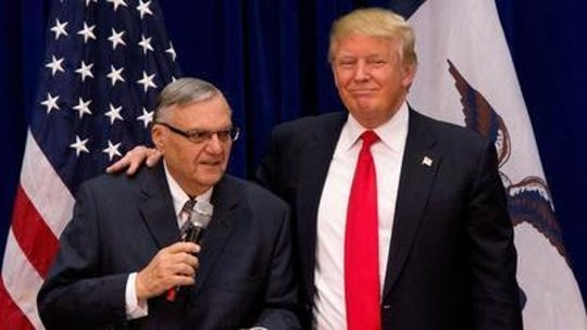 Joe Arpaio and Donald Trump appear at an Iowa campaign event in 2016.