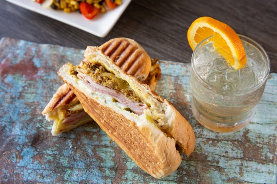 The Original Cuban Sandiwch at Little Cay includes roasted pulled pork, ham, Swiss cheese and pickles.