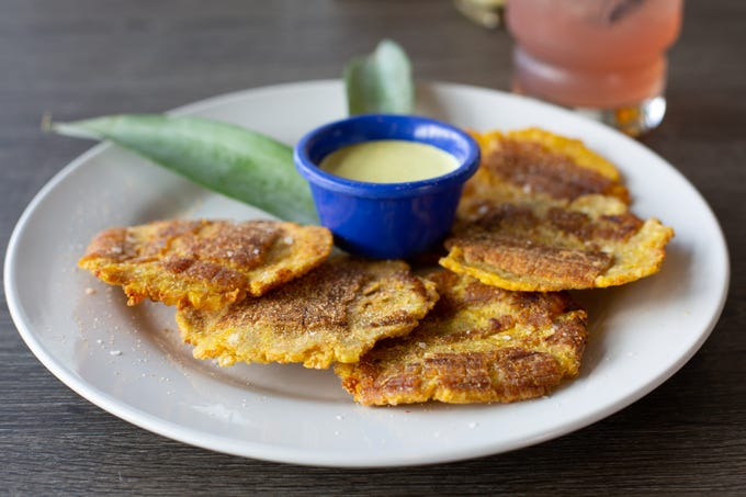 Little Cay serves plantains prepared several ways including double cooked with ketchup mayo, called Tostones.