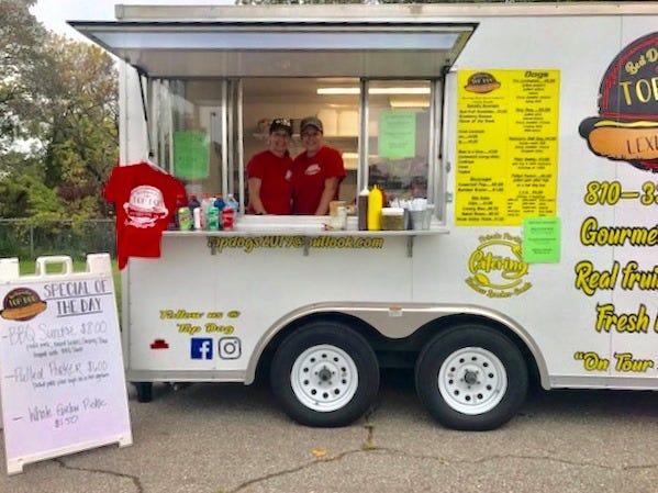 Debbie Strausser and her daughter Taryn Strausser run their food truck Top Dog at a Detroit event.