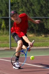 Sandusky boys tennis player Caleb Minard swings during a recent match.
