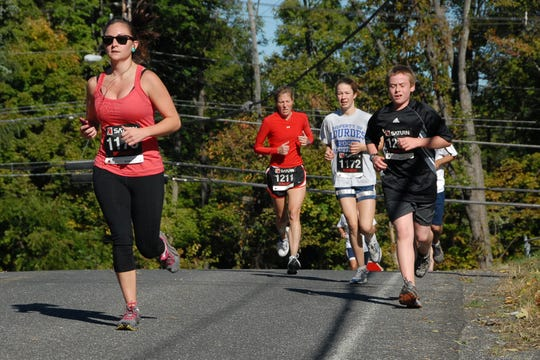 "Runners take part in the 2011 Schlathaus Park 5K, otherwise known as the ""Pumpkin Run."" The race is cancelled this year due to low registration."