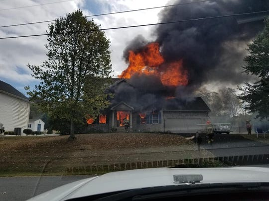 A family has been displaced after a massive fire burned through their home Sunday afternoon.