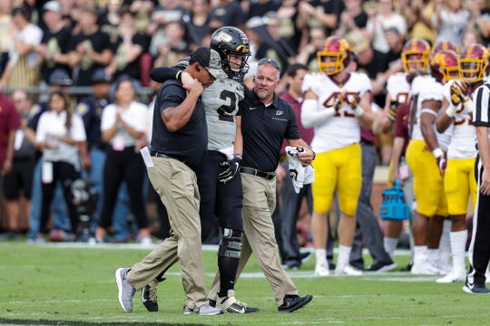 Purdue quarterback Elijah Sindelar (2) is helped off the field after being injured against Minnesota in West Lafayette, Indiana last Saturday. Sindelar won't play this Saturday against Penn State. (AP Photo/Michael Conroy)