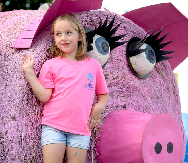 Emma Wilt, 6, rides the York County 4-H Swine Club float during a parade honoring emergency responders at the York Fair Sunday, Sept. 8, 2019. Bill Kalina photo