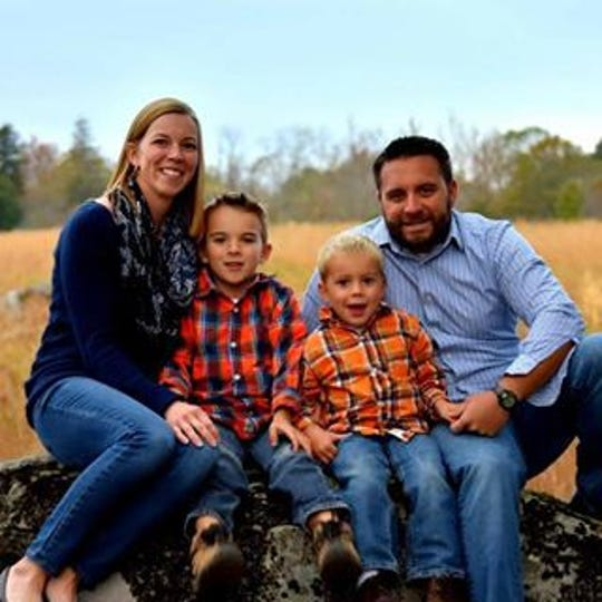 New Oxford High School boys' tennis coach Travis Martin is shown with his family.