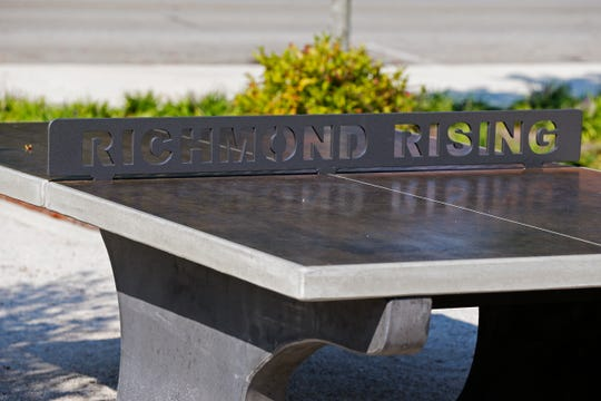 A concrete ping pong table is among the new additions to Elstro Plaza in downtown Richmond.