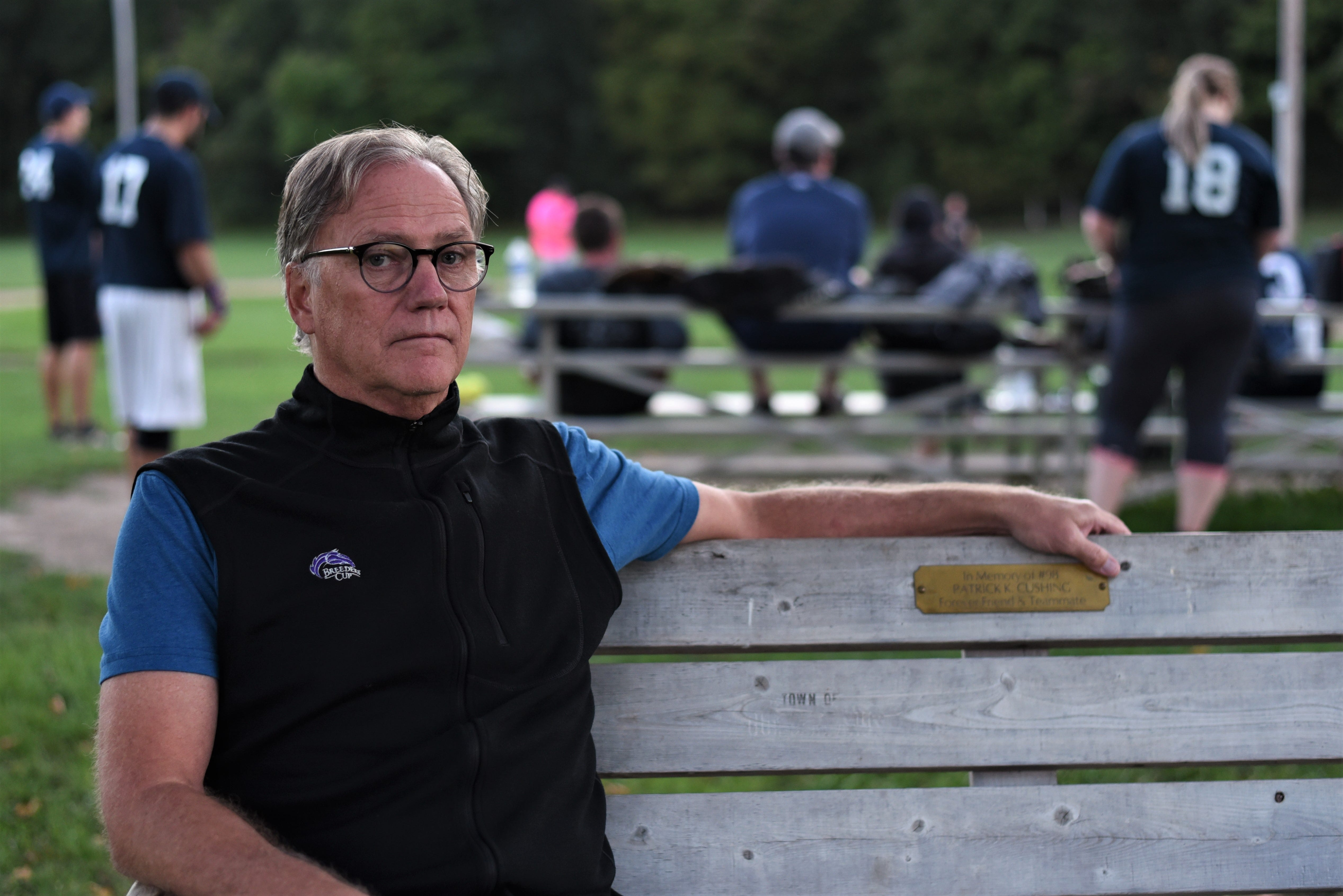 Kevin Cushing sits at a bench honoring his late son, Patrick Cushing, at Nott Road Park in Guilderland, New York on Monday, Sept. 16, 2019. The bench is right next to third base on the field where Patrick Cushing played in his last game before his death on Oct. 6, 2018.