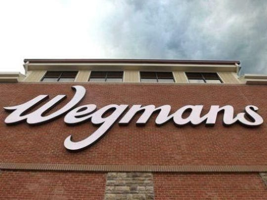 More than 3,000 people lined up Sunday morning in advance of the grand opening of Wegmans' Raleigh, North Carolina, store.