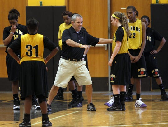 A 2010 file photo of former Monroe Community College women's basketball coach Tim Parrinello. Parrinello has not been employed at MCC since Sept. 1 and the college has canceled the 2019-20 women's basketball season due to low roster numbers.