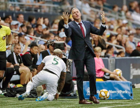 Sporting Kansas City manager Peter Vermes reacts to a play against the Portland Timbers during the first half at Children's Mercy Park.