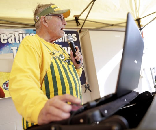 Paul Mesich of Sheboygan DJs at Creative Finishes Tailgate Zone near Lambeau Field before a Green Bay Packers game on Sept. 26, 2019, in Green Bay, Wis.