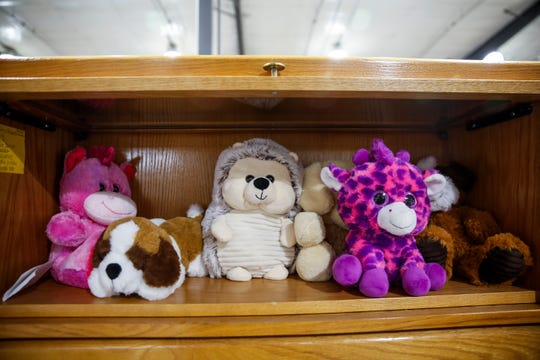 Inmates create weighted stuffed animals to be used in schools in the garment workshop in Pheasantland Industries on Friday, Sept. 27, 2019.