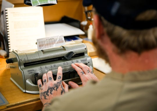 An inmate in the braille workshop translate and create tactile textbooks to be used in schools in Pheasantland Industries on Friday, Sept. 27, 2019.