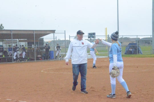 Dell Rapids head coach Dennis Klein fist bumps Cora Alderson between innings on Sunday, Sept. 29 at a game in Tea.