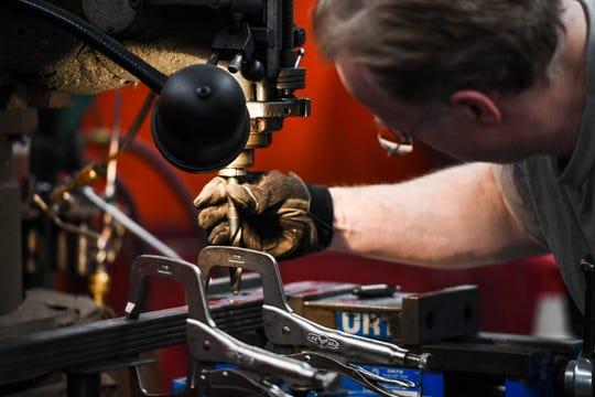 An inmate works in the metal smithing workshop in Pheasantland Industries on Friday, Sept. 27, 2019.