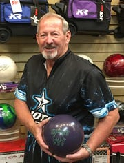 Doug Love poses with his ball after rolling 23 strikes during a 693 series at the Virgin River Bowling Center in Mesquite.