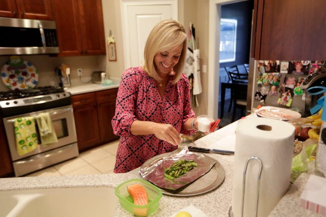 For breast cancer awareness month, Anna Jones prepared salmon and asparagus foil packets and red cabbage and apple slaw.