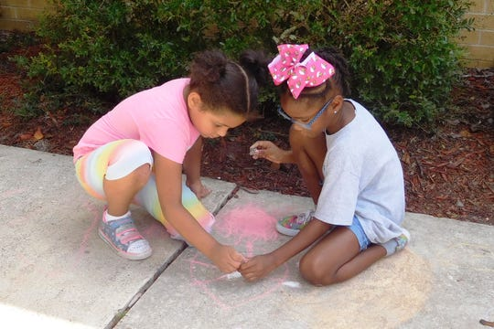 Students were encouraged to practice peaceful collaboration in the creation of their sidewalk artworks.