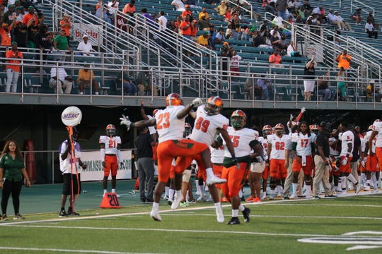 FAMU running back Terrell Jennings (23) celebrates a touchdown with tight end Marquan Cromartie. Jennings rushed for two scores in the 30-28 victory over Norfolk State.