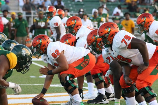 FAMU offensive linemen look over the defensive alignment.