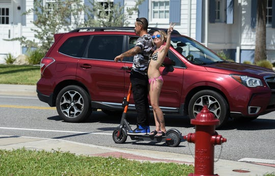 Matthew Ramirez, of Okeechobee, and his girlfriend Christy Boland, of Fort Pierce, have fun riding along Seaway Drive on Sunday, Sept. 29, 2019, in Fort Pierce. Treasure Coast residents try out the new e-scooters located around downtown Fort Pierce, along Seaway Drive, and several Fort Pierce beaches. The electric scooter share program has 150 scooters deployed daily at designated locations. It costs $1 to unlock and rent, along with 15 cents per minute to ride. Operators need to be ages 18 and older to rent and ride, with a valid drivers license. The e-scooters will be available to ride from 7 a.m. to 9 p.m.