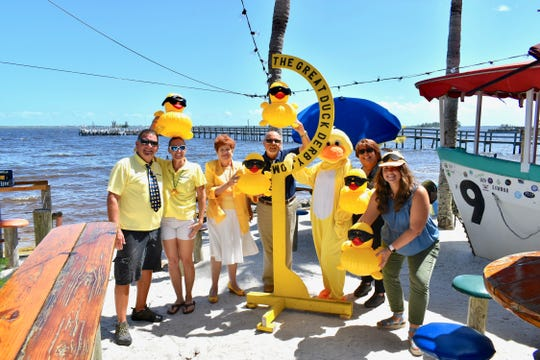 John and Amy Donaldson, left, of Sea Tow Sebastian; Vicki Soule, Dennis Bartholomew, Quackers, and Colette Heid, all of Treasure Coast Community Health; and Sam Vash of Capt. Hiram's prepare for the Great Duck Derby on Oct. 20 at Capt. Hiram's Sand Bar in Sebastian.