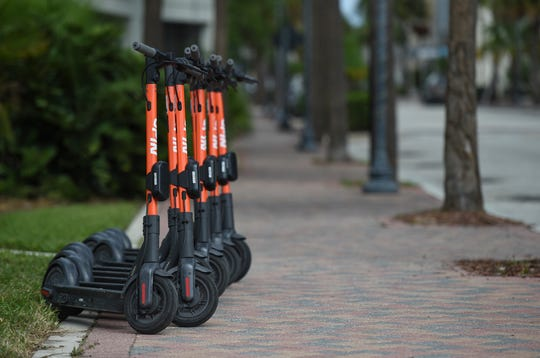 Several e-scooters are seen parked along 2nd Street across from the St. Lucie County Courthouse, one of many designated locations in Fort Pierce. Treasure Coast residents try out the new e-scooters located around downtown Fort Pierce, along Seaway Drive, and several Fort Pierce beaches. The electric scooter share program has 150 scooters deployed daily at designated locations. It costs $1 to unlock and rent, along with 15 cents per minute to ride. Operators need to be ages 18 and older to rent and ride, with a valid drivers license. The e-scooters will be available to ride from 7 a.m. to 9 p.m.