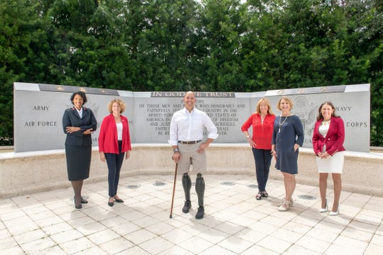 The 2019 Wings of Hope Luncheon features Congressman Brian Mast as guest speaker. Pictured are, from left, Salvation Army Corps Officer Lt. Sheena Marquis, Salvation Army Public Relations/Volunteer Manager Kim Johnson, Mast, and Luncheon Committee Chairs Carolyn Timmann, Vicki Davis and Ruth Pietruszewski.
