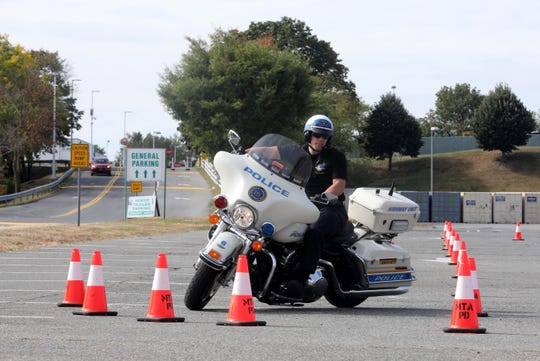 Monday, Sept. 30th: Nick Notarfrancesco, a police officer with the Metropolitan Transit Authority, navigates cones as he trains to become a motorcycle officer with the MTA's Highway Unit during the first day of a two-week motorcycle certification course taking place in the parking lot of Yonkers Raceway. Four MTA officers are taking the course, which is based on the Yonkers Police Department's motorcycle training course. Notarfrancesco has been an MTA police officer for six years.