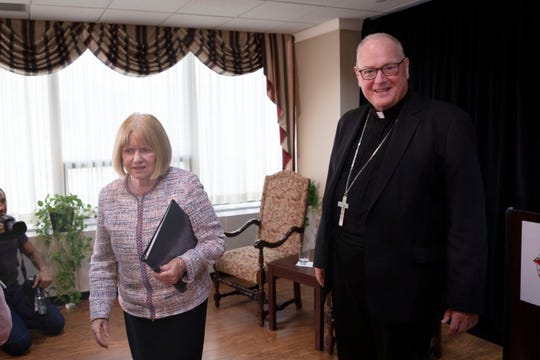 Judge Barbara Jones, left, and Cardinal Timothy Dolan, archbishop of New York, give a news conference, Monday, Sept. 30, 2019 in New York. She made a year-long review of the policies and procedures for responding to allegations of sexual abuse within the New York archdiocese.