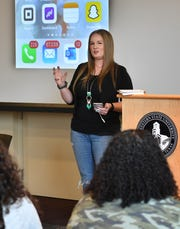 Jessica Edwards, co-founder of Frank & Joe's Coffee Houses and owner of Primp & Blow, speaks to a group of students at Midwestern State University Monday morning during the fourth annual Social Media Day.