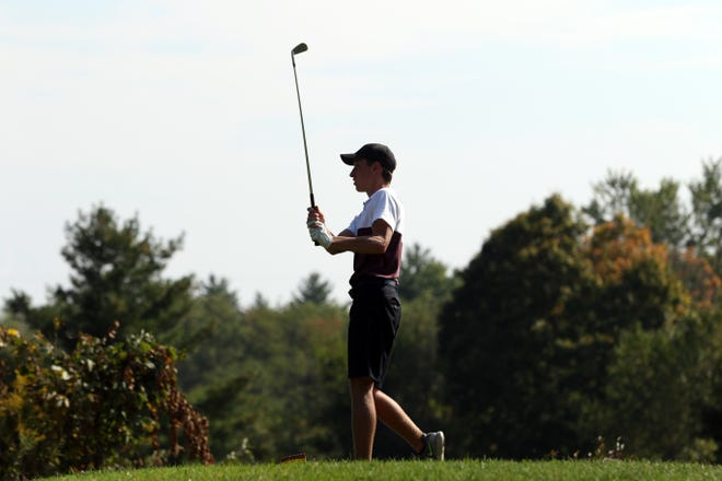 John Glenn's Brady Graham tees off on Monday at EagleSticks Golf Club during the Division II district tournament. Graham shot a season-best 75 to help send the Muskies to their second state tournament in three years.