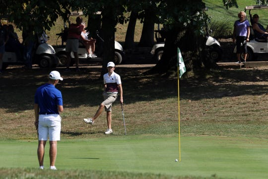 John Glenn's Bo Orecchio reacts after narrowly missing a putt during the Division II districts at Eaglesticks on Monday.