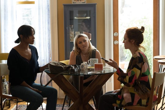 "Megalyn Echikunwoke, Emily Osment and Brittany Snow in ""Almost Family."""