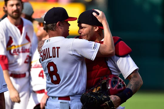 Cardinals manager Mike Shildt celebrates with catcher Yadier Molina.