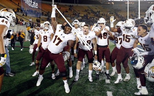 Arizona State defensive lineman George Lea (17) celebrates with teammates after their defeat of California.