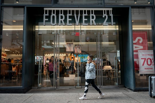 "A Forever 21 store stands in Herald Square in Manhattan on Sept. 12, 2019 in New York City.    Fashion retailer Forever 21 filed for Chapter 11 bankruptcy protection Sept. 29, 2019, hobbled by expensive leases and declining mall traffic. The family-owned company said it would close ""most"" of its stores in Asia and Europe and up to 178 stores in the U.S."