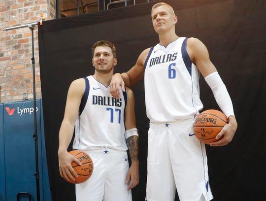 The Dallas Mavericks' Luka Doncic and Kristaps Porzingis pose for photos.