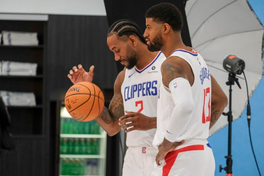 Kawhi Leonard and Paul George at Clippers media day.
