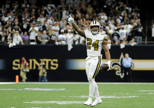 New Orleans Saints strong safety Vonn Bell (24) celebrates after recovering a fumble during the second quarter against the Dallas Cowboys at the Mercedes-Benz Superdome.