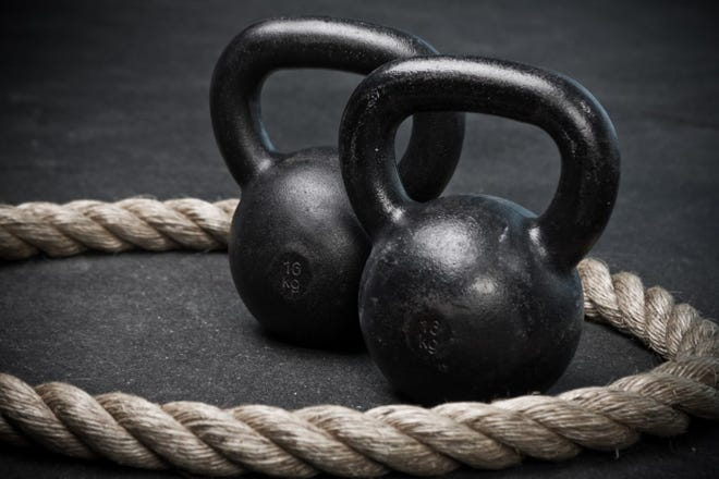 Two kettlebells and a battle rope.