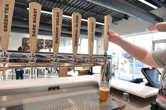 Dunkin' new tap system pours its cold beverages, including ice teas and cold brew coffee.