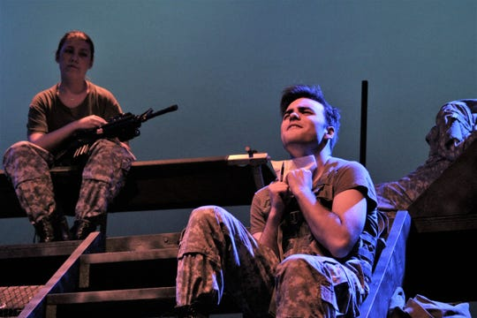 """Marine Tommy Keller (Ryver Watson) agonizes about writing a letter home from Afghanistan to his sweetheart with his CO, Siyah Powell (Abby Boyles) in this rehearsal scene from Cooper High's """"The Steadfast,"""" its fall drama."""