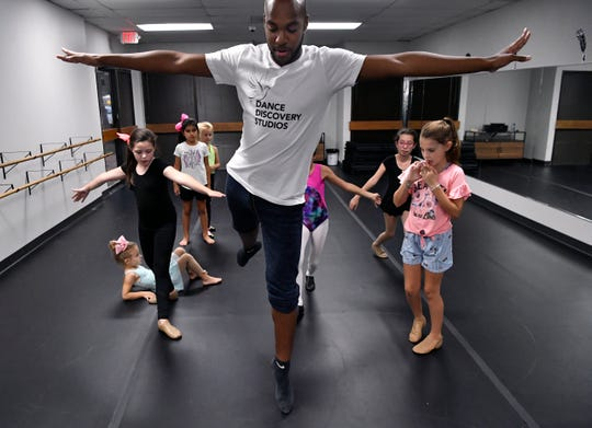 Domonique Gordon demonstrates the next exercise he wants his students to attempt during a class at Dance Discovery Studios on Sept. 25. The dance school, which was devastated by a tornado May 18, has a new home with more room just a few blocks from its former location.