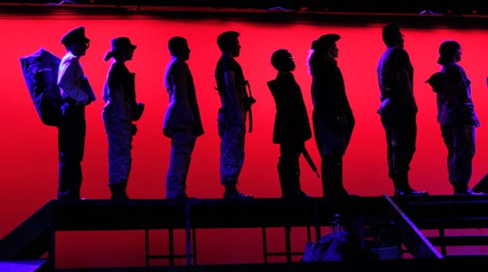 """Silhouettes of soldiers of different American wars hit the stage in this rehearsal scene from Cooper High's """"The Steadfast."""""""