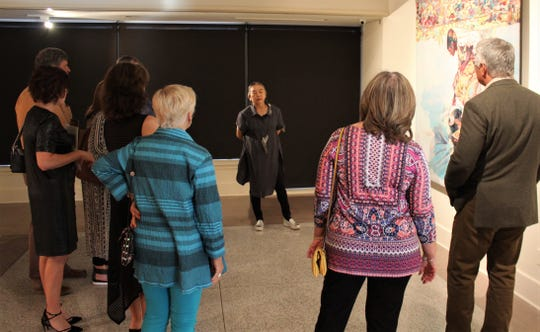 Artist Hung Liu answers questions about her art in the main gallery of The Grace Museum before her talk Friday evening. Sept. 27 2019