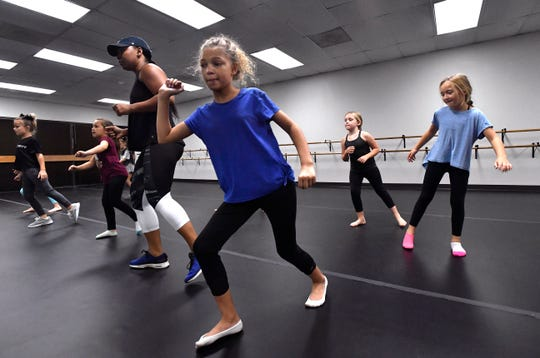 Lyric Reeves (center) follows along with instructor Lindsay Palmer during a jazz dance class at Dance Discovery Studios on Sept. 25.