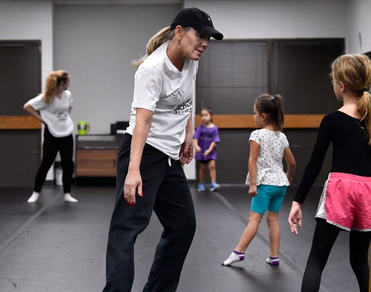 Dance Discovery Studios owner Teri Wilkerson gives a few pointers to a young student Sept. 25.